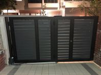 SINGLE LEAF TRACKLESS FOLDING GATE