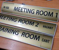 door sign with aluminium holeder plate