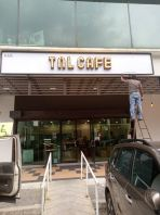 'TnL Cafe' Signage With Light Bulb